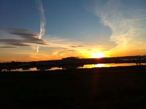 Kvälls sol över Saltsjön och fabrik...